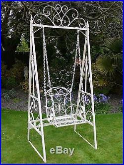 Antique white ornate vintage garden swing
